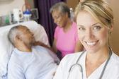 Doctor Smiling,Standing In Patients Room — Stock Photo