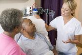 Doctor Explaining To Senior Couple — Stock Photo