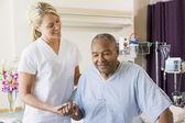 Nurse Helping Senior Man To Walk — Stock Photo
