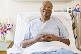 Senior Man Sitting In Hospital Bed,Smiling — Stock Photo