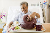 Senior Woman Sitting In Hospital Bed With A Tray Of Food — Stock Photo