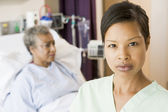 Nurse Standing In Patients Room Looking Serious — Stock Photo