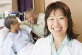 Nurse Smiling In Hospital Room — Stock Photo