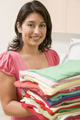 Woman Holding Fresh Laundry — Stock Photo