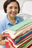 Woman Holding Folded Laundry — Stock Photo