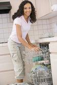 Woman Loading Dishwasher — Stock Photo