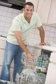 Man Loading Dishwasher — Stock Photo