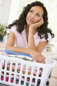 Woman Daydreaming Over Washing Basket — Stock Photo