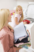 Mother And Daughter Doing Laundry — Stock Photo