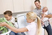 Father And Children Doing Laundry — Stock Photo