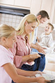 Family Cleaning Dishes Together — Stock Photo