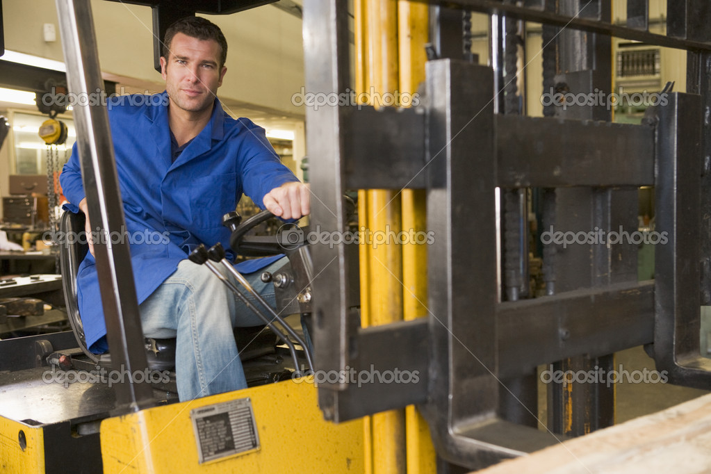 Warehouse worker in forklift — Stock Photo #4770458