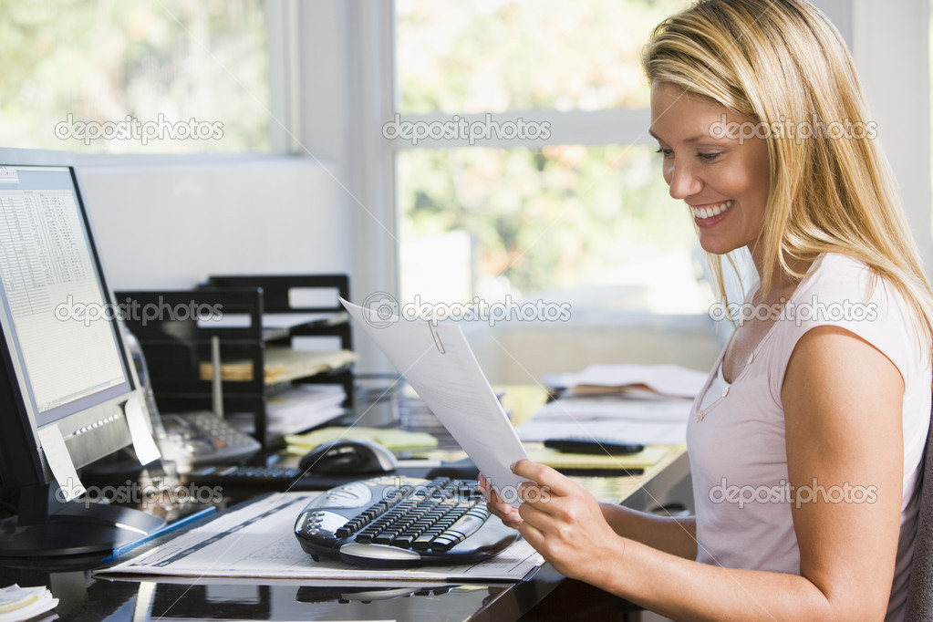 Sensational Woman In Home Office With Computer And Paperwork Smiling Stock Largest Home Design Picture Inspirations Pitcheantrous