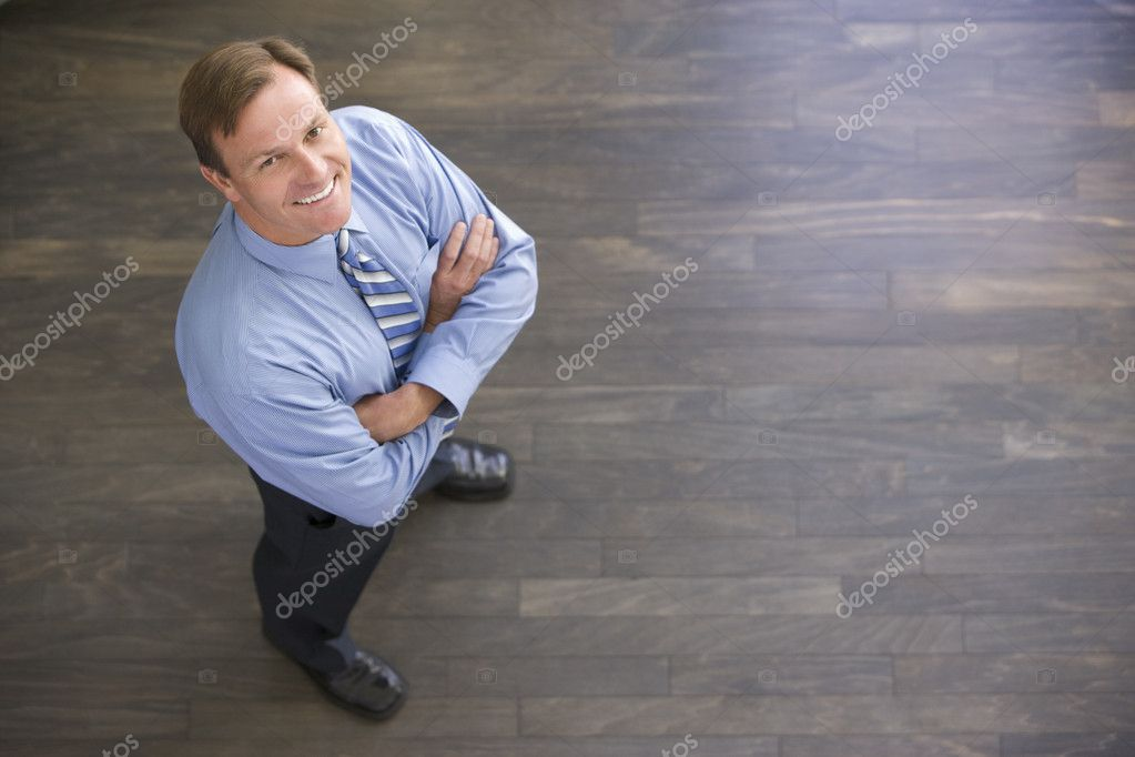 Businessman standing indoors smiling — Stock Photo #4771934