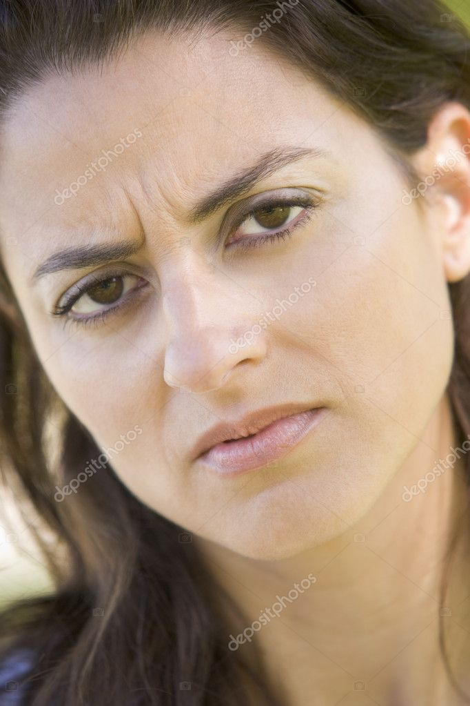 Head shot of woman scowling — Stock Photo #4777916