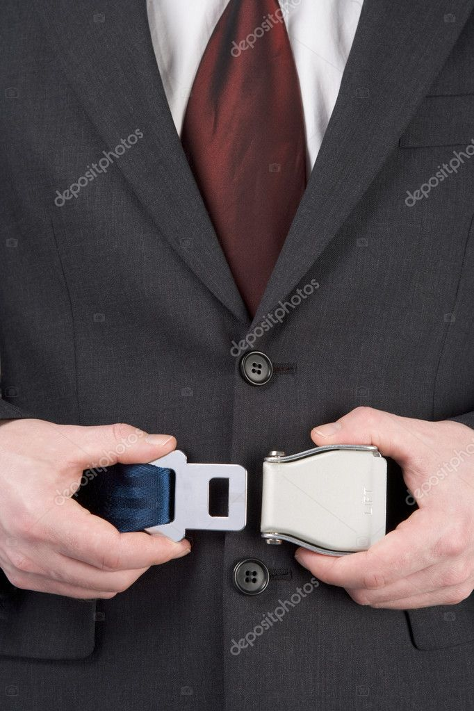 Businessman Fastening Safety Belt — Stock Photo #4778001