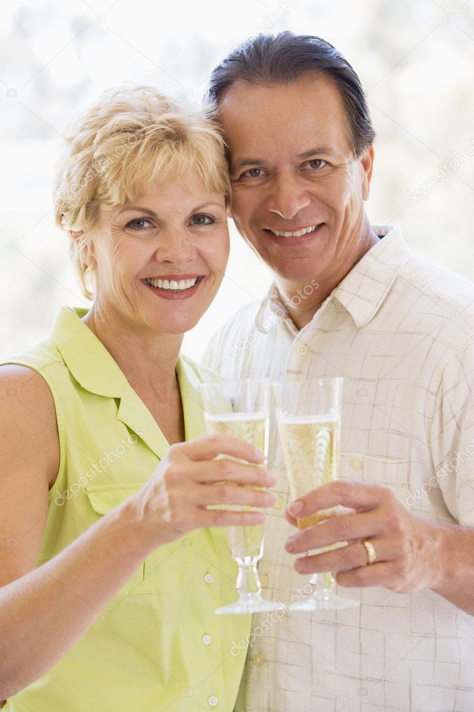 Couple toasting champagne and smiling — Stock Photo #4778122