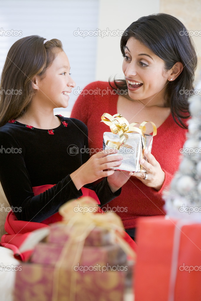 Girl Surprising Her Mother With Christmas Gift — Stock Photo #4778303