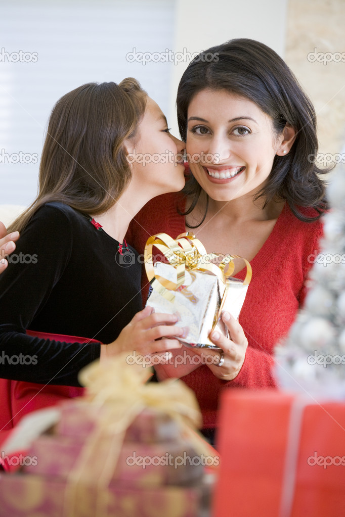 Girl Surprising Her Mother With Christmas Gift  Lizenzfreies Foto #4778307