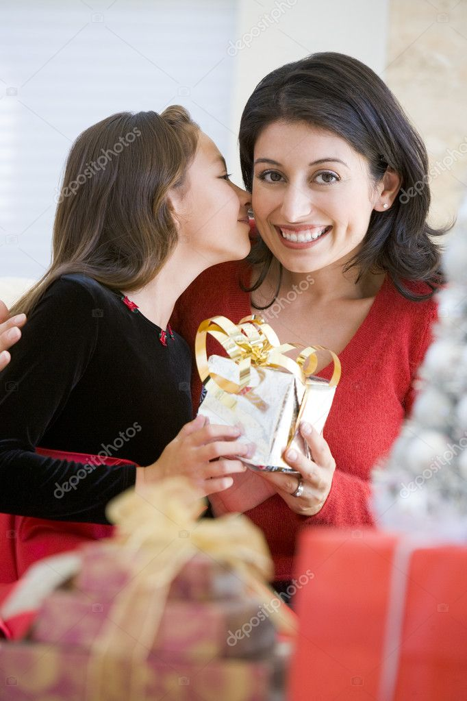 Girl Surprising Her Mother With Christmas Gift  Foto de Stock   #4778307