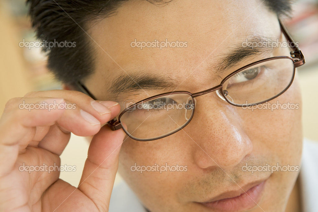 Man Looking Through New Glasses — Stock Photo #4779081