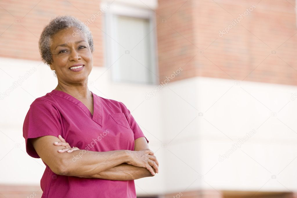 Nurse Standing Outside A Hospital — Stock Photo #4779374
