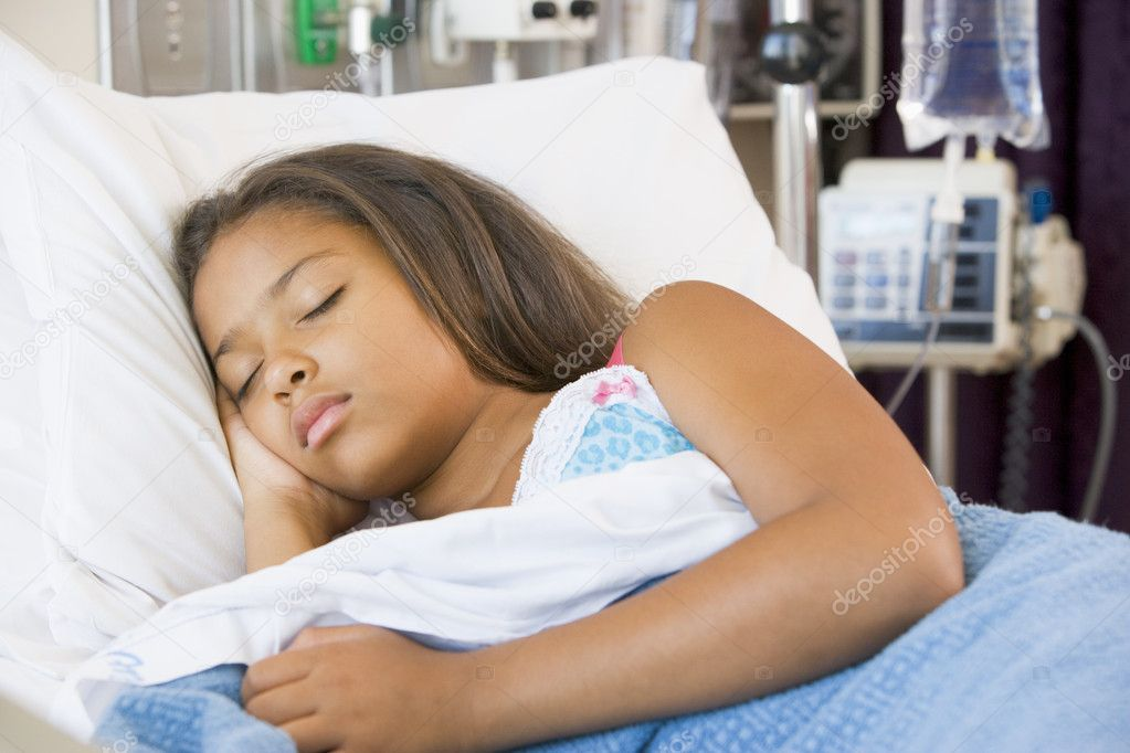 Young Girl Sleeping In Hospital Bed Stock Photo
