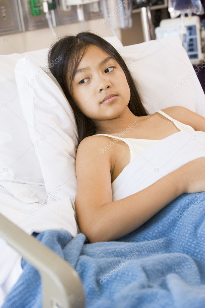 Young Girl Lying In Hospital Bed Stock Photo