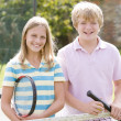 Stock Photo: Two young friends with rackets