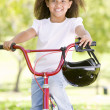 Young girl on bicycle outdoors smiling — Stock Photo #4780079