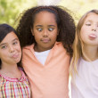 Three young girl friends outdoors making funny faces — Foto Stock