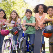 Stock Photo: Five young friends with bicycles scooters and skateboard outdoor