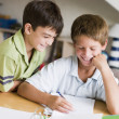 Stock Photo: Two Young Boys Doing Their Homework Together