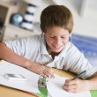 Stock Photo: Young Boy Doing His Homework