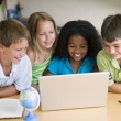 Group Of Young Children Doing Their Homework - Stock Photo