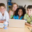 Group Of Young Children Doing Their Homework — Stockfoto