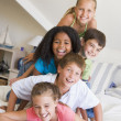 Five Young Friends Lying On Top Of Each Other — Stock Photo #4780337