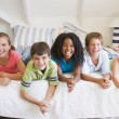 Five Young Friends Lying Down Next To Each Other — Stock Photo