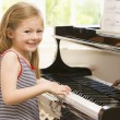 Young Girl Playing Piano — Stock Photo