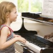Young Girl Playing Piano — Foto de stock #4780418