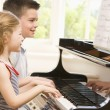 Stock Photo: Brother And Sister Playing Piano