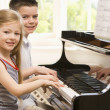 Brother And Sister Playing Piano — Stock Photo