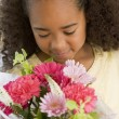 Young Girl Smelling A Bouquet Of Flowers — Stock Photo