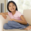Young Girl Sitting On A Sofa At Home — Stock Photo #4780435