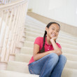 Young Girl Sitting On A Stairwell At Home — Stok fotoğraf #4780455