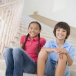 Brother And Sister Sitting On A Stairwell At Home — Stock Photo #4780462