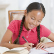 Foto Stock: Girl Doing Her Homework