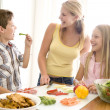 Mother And Children Prepare A meal,mealtime Together — Stock Photo #4780849