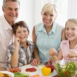 Stockfoto: Grandparents And Grandchildren Prepare A meal,mealtime Together