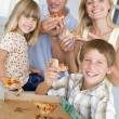 Stock Photo: Family Eating Pizza Together